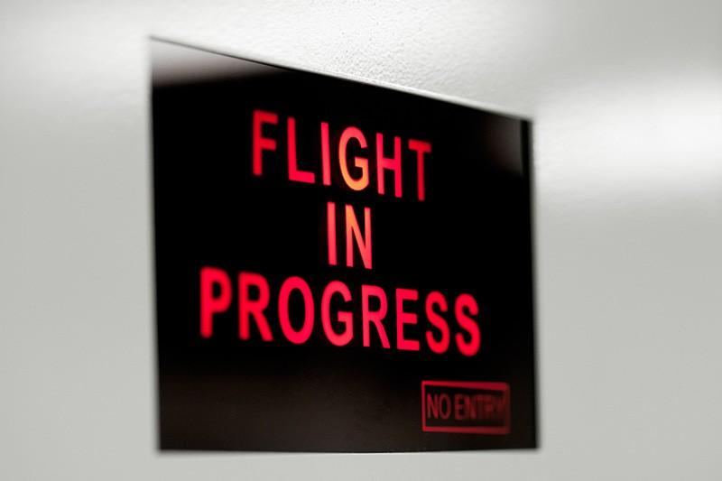 Flight In Progress Sign